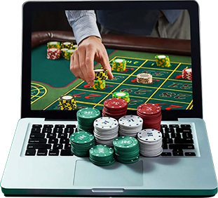 Casino table as background in the laptop and casino chips on top of laptop