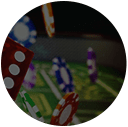 Casino chips and dices in front of casino table background.